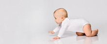 Chubby Ginger Baby Boy In Bodysuit, Barefoot. He Smiling, Creeping On Floor Isolated On White Background. Close Up, Copy Space