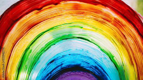 Fototapeta Close-up photo of painting rainbow on window