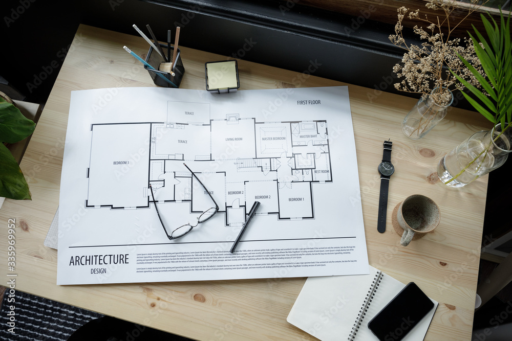 Fototapeta Top view workspace mockup of architectural project with architectural project plan, engineering tools, office supplies and hot coffee cup on wooden desk empty space