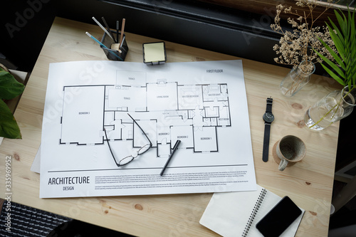 Obraz Top view workspace mockup of architectural project with architectural project plan, engineering tools, office supplies and hot coffee cup on wooden desk empty space - fototapety do salonu