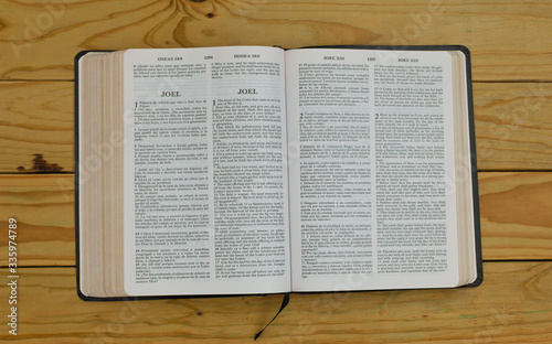 open bilingual bible book on Joel, Spanish and english Canvas Print