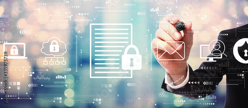 Fotografía Data protection concept with businessman on blurred abstract background