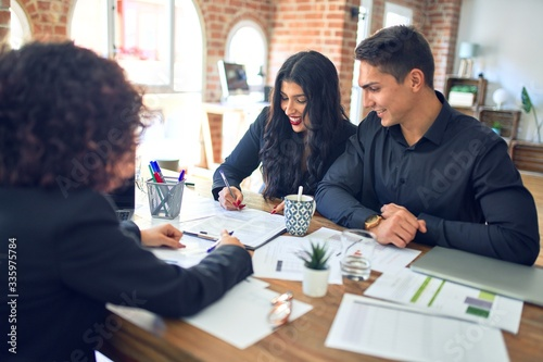 Photo Young beautiful couple applying for mortgage