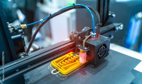 Fototapeta 3D printer or additive manufacturing and robotic automation technology