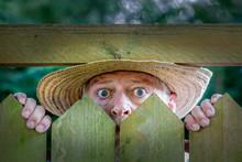 An Elderly Man In A Straw Hat ...