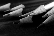 Wooden Pencil On Black Background