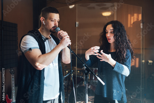 Fotografia Musical teacher coaching a young male vocalist