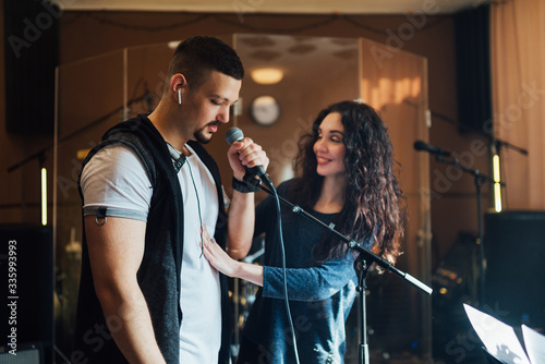 Woman coaching a male vocalist or singer Canvas Print