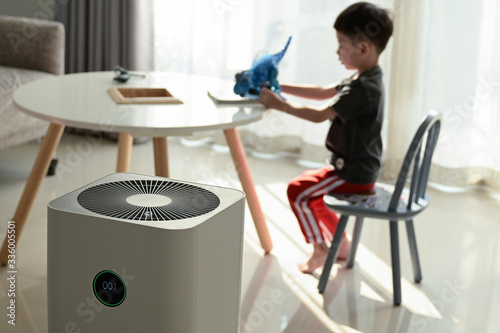 air purifier in living room with kid playing inside home Canvas Print