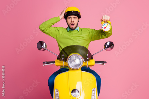 Valokuva Portrait of his he nice attractive unlucky sad nervous worried guy riding moped