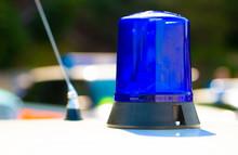Close Up Of Police Blue Light Atop Of A Patrol Car.