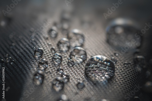 Obraz Many water drops on waterproof impregnated fabric of black umbrella. - fototapety do salonu