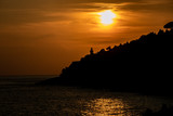 Fototapeta Na ścianę - silhouette of a lighthouse in Circeo national park at sunset. Latina, Lazio, Italy