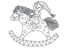 A Kitten On A Rocking Horse. D...