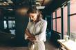 Leinwanddruck Bild - Businesswoman looking happy in office