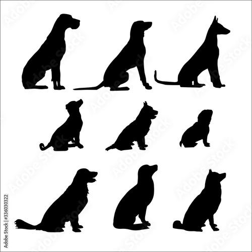 Nine Black Sitting Dog. Vector black illustration Wall mural