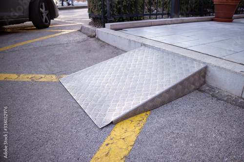 Ramp for disabled persons on wheelchair at building entrance. Fotobehang