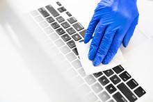 A Hand In A Blue Glove Cleanin...
