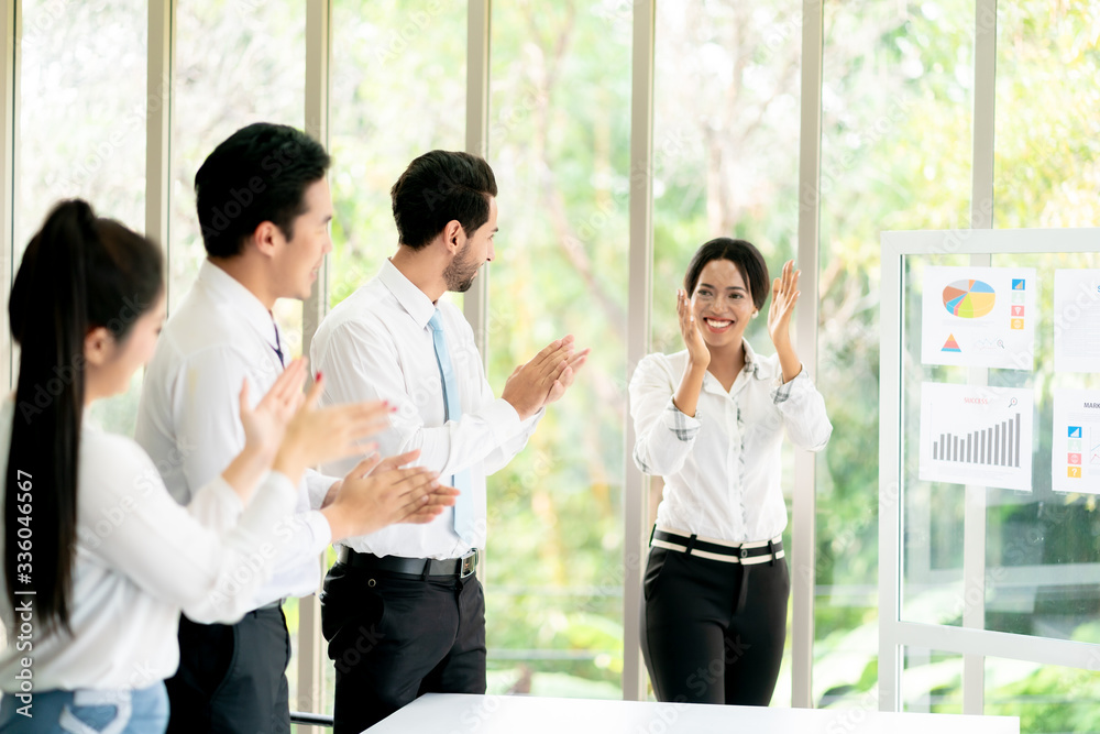 Fototapeta Group of Business applauding while in a meeting at modern office.