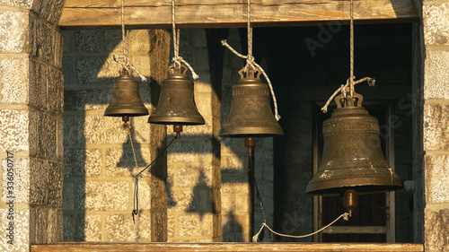 Fotografie, Obraz Bells at the Church on top of the Mount Athos in sinrise rays