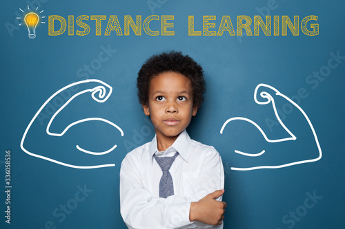 Fotografía Distance learning concept with clever black kid on blackboard background