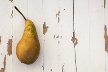 A Solitary Pear Against A Whit...