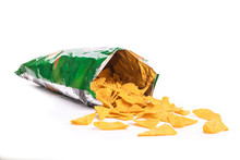 Heap Of Open Packages And Corn Chips On A White Background