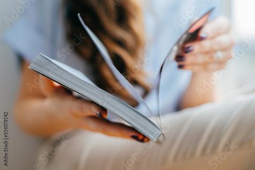 Fotografija home and leasure concept - smiling woman reading magazine at home near the windo