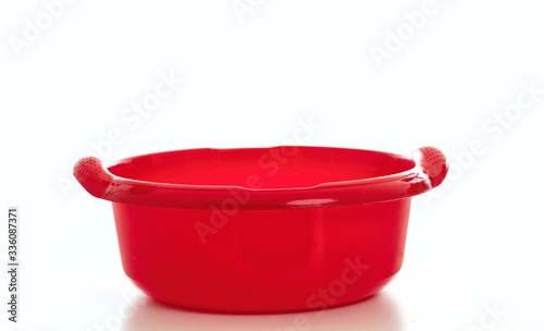 Fotomural Cleaning washbowl red color isolated against white background,
