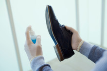 Man Disinfecting His Shoes