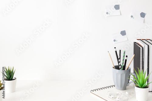 Obraz School desk against a white wall. - fototapety do salonu