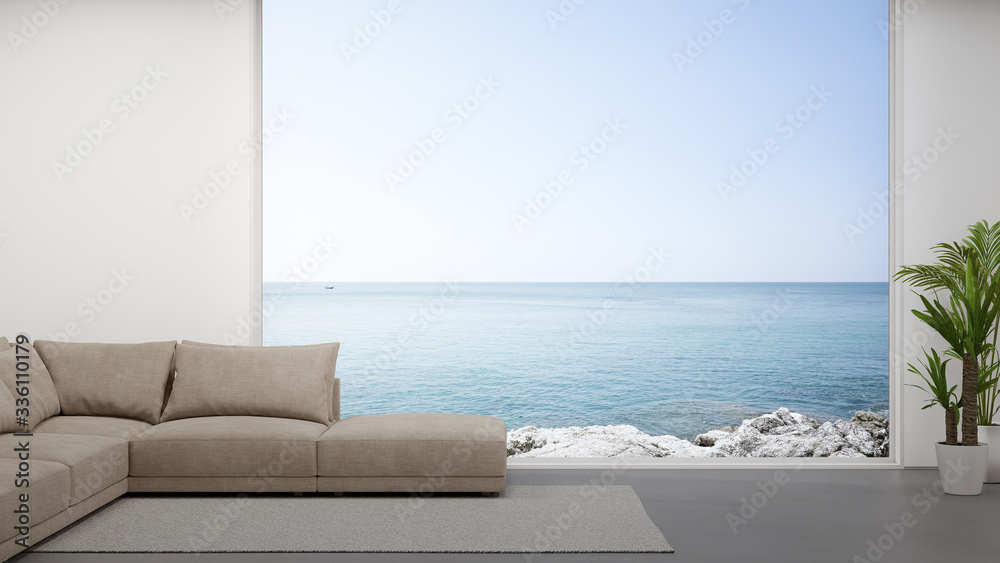 Fototapeta Sofa on concrete floor of large living room in modern house or luxury hotel. Minimal home interior 3d rendering with sky and sea view.