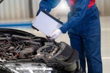 Car Mechanic Is Changing Car B...