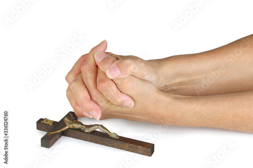 Photo Praying for Peace this Easter - female hands in prayer position laid next to a w