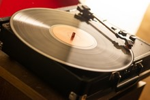 Closeup Of Vinyl On A Player On The Table Under The Sunlight With A Blurry Background