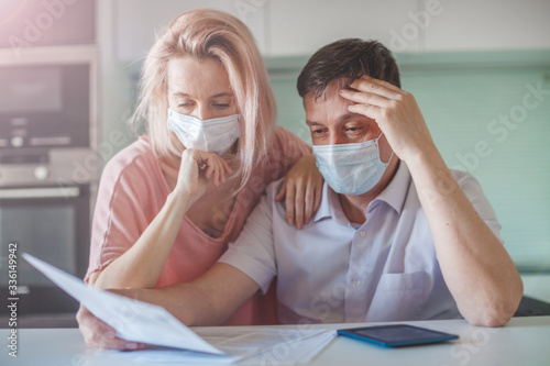Fotografiet Couple worried about money problem during the pandemic coronavirus