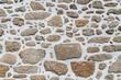 Garten und Landschaftsbau: Hintergrund Mauer Wand aus verputzten Natursteinen