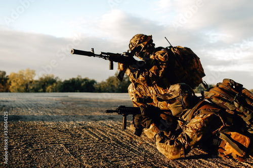 Two soldiers in a shelter armed with sniper rifles aim at the enemy while protec Canvas Print