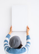 canvas print picture - Girl hanging white canvas on wall