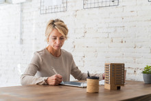 Mature Woman Working At Desk I...