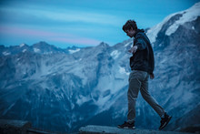 Young Man Balancing On A Wall ...