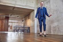 Senior Businessman Skateboardi...
