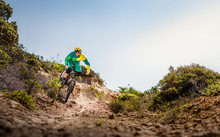 Man Riding Mountainbike On Dirt Track, Fort Ord National Monument Park, Monterey, California, USA