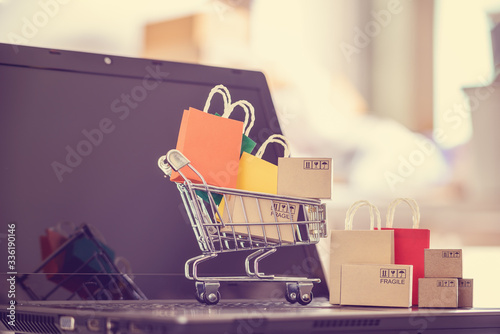 Fotografering Online shopping / e-commerce and customer experience concept : Shopping cart wit