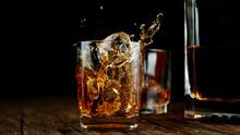 Splashing Whiskey From Glass W...