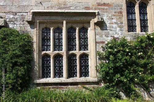 Photo Saltash (England), UK - August 21, 2015: An old window Cotehele park, near Saltash,  Cornwall, England, United Kingdom