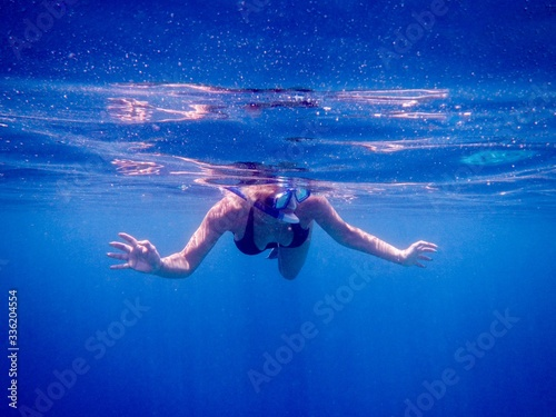 Closeup shot of a woman swimming the water wearing aqualungs Canvas Print