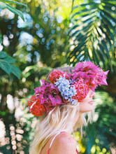 Blonde Woman With Floral Crown And Palm Trees And Flowers Being Happy And Joyful With Rainbow Stripes