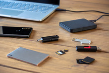 Various Digital Data Storage Devices. Usb Sticks, External Hard Drive, SD Cards, Mini And Micro SD Cards, Laptop And Smartphone