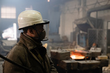 Foundry Worker In Helmet And M...